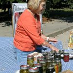 Johnnie Luehrs selling items for the garden club