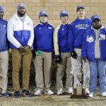 Lake View Coaches with the trophy