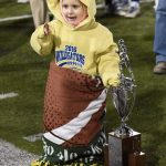 Coach King's daughter with the trophy