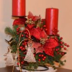 Poinsettia and candle decoration with angels out front