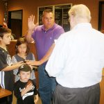 COUNCILMAN JOHNNY ELLER takes the oath of office as his children Ethan, Haidan, and Easton stand with him. The oath was administered by City Attorney Jack McInnis. (Photo by Betsy Finklea/The Dillon Herald