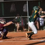 #6 Kyra Grant punches one to third. There is an out at second, but she is safe at first.