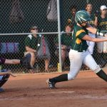 #12 Macy Hyatt hits one up the middle.